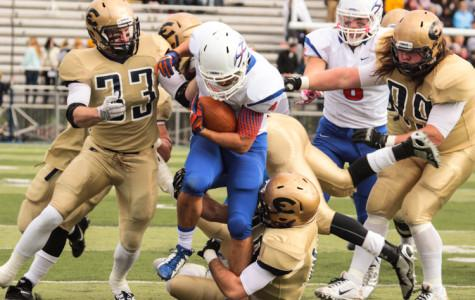 Pioneers thump football team