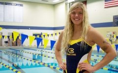 Eau Claire swimmer sets records, leads by example