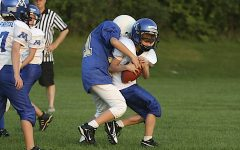 Should parents allow their child to play tackle football?