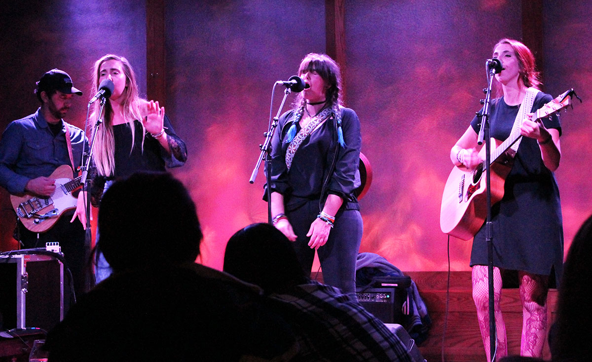 The three lead vocalists, Bex Morton (left), Hannah Morton (middle) and Mookie Morton (right) along with their electric guitarist, Evan Middlesworth (far left), performed a set compiled of their originals from their first EP and singles.