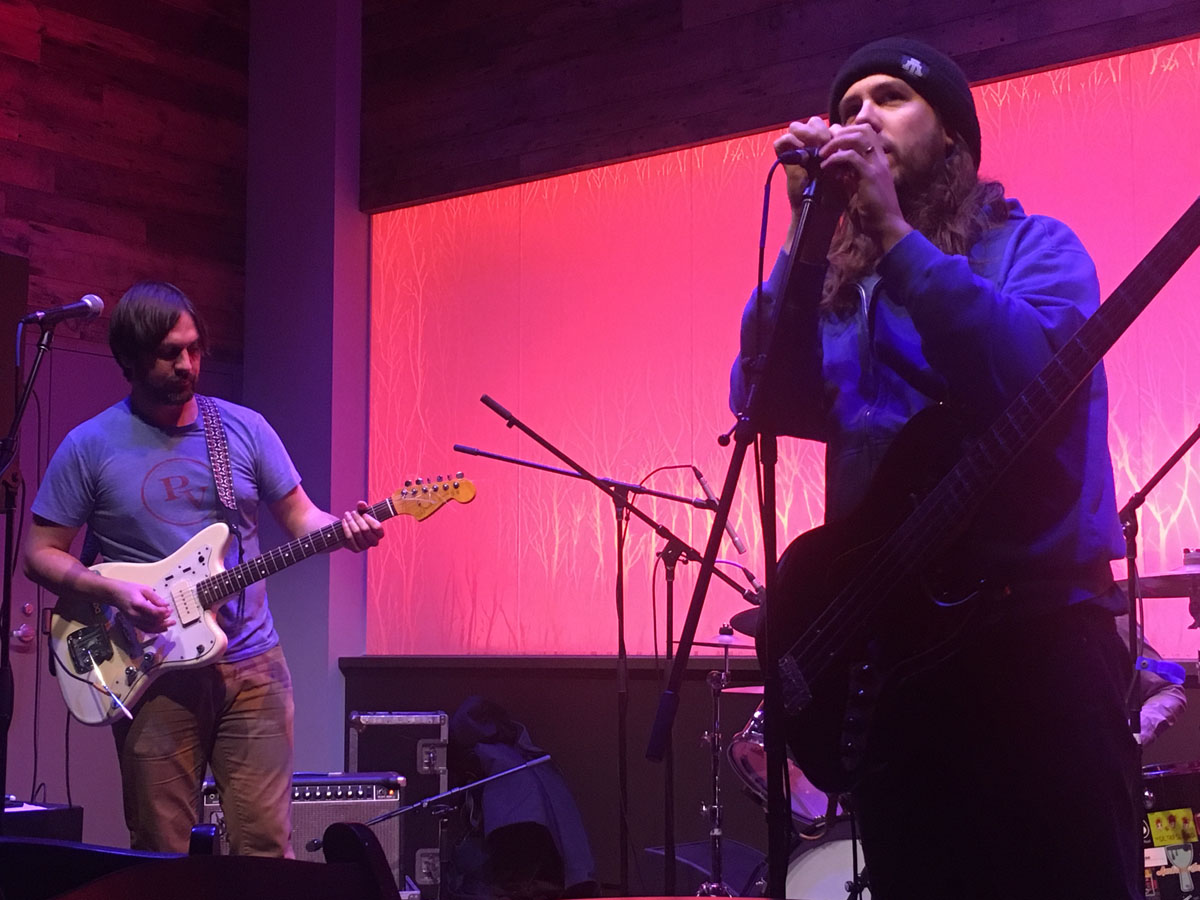 Whalehouse members rock out Friday night at the Cabin, showing the audience their 90s grunge-inspired music.