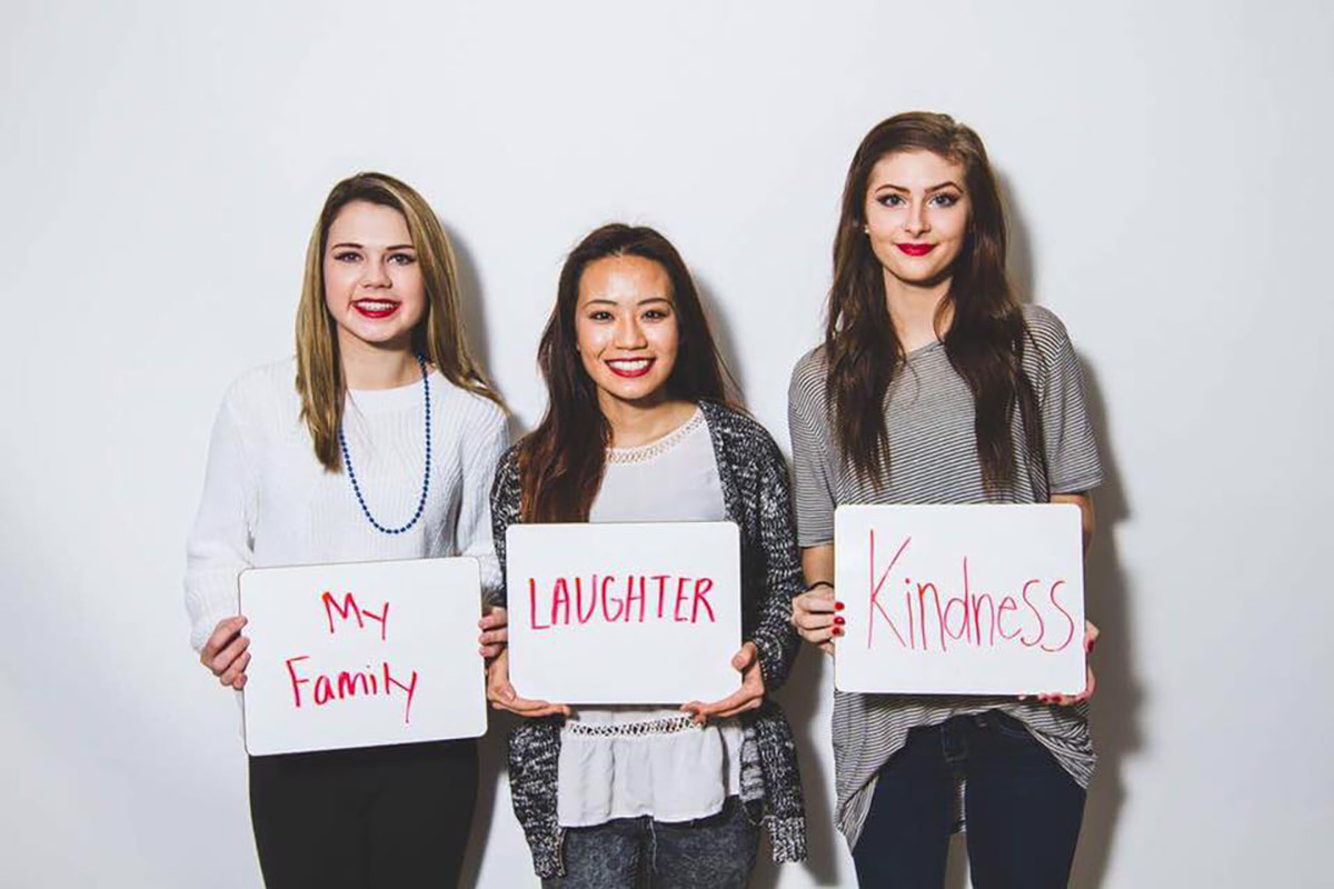 Participants in the Red Lips Project will have their photo taken with what makes them feel powerful. (Pictured left to right: Taylor Stoltz, Wendy Vang and Madi Mischo) (Submitted)