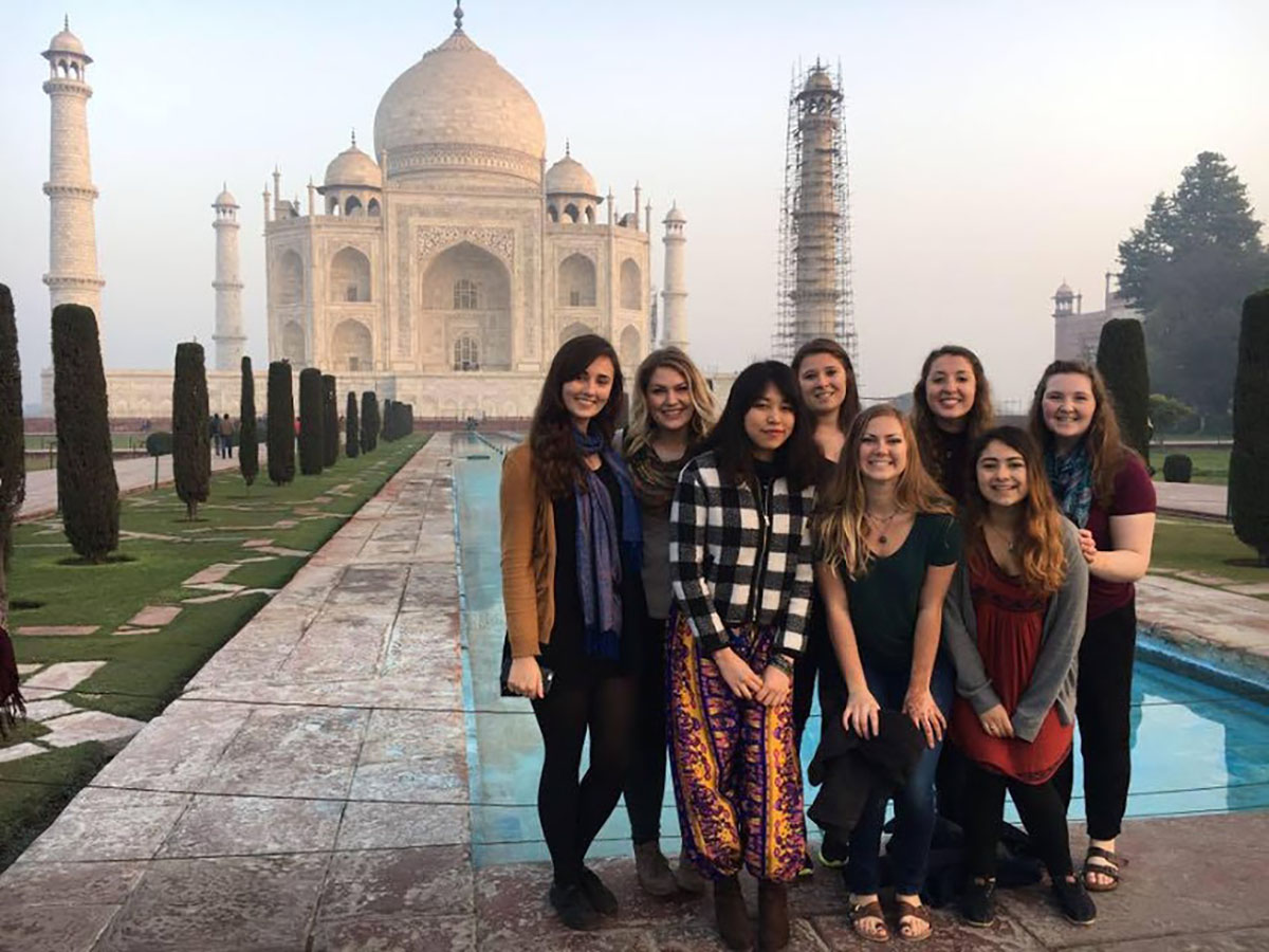 Course members stand in front of the Taj Mahal. The Blugold women's studies students were studying in India over winterim for just shy of three weeks. After listening to lectures, participating in discussion and working in fieldwork projects, the students presented their findings to one another.