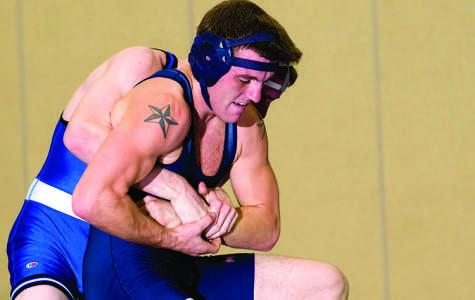 Ames in as interim wrestling coach