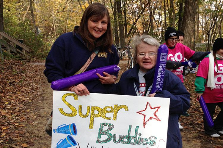 Blugold Angie Hershey and community buddy Michelle Pederson show off their Super Buddies sign at the first annual Friendship Walk.