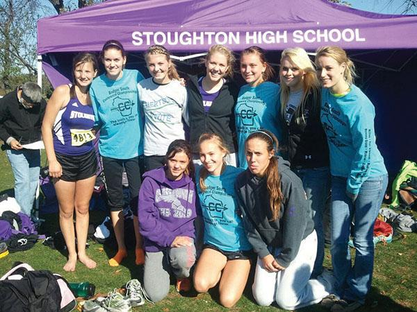 Shelby Knispel, second from left, with her high school cross country team.