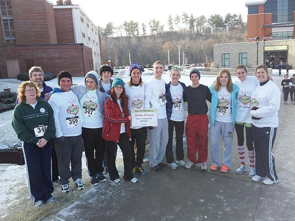 SUBMITTED PHOTOS   Shelby Knispel, second from right, and her supporters at the 2012 Jingle Bell Walk/Run in Eau Claire.