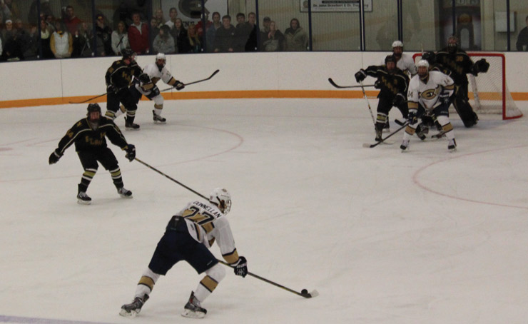 Senior defenseman David Donnellan scored the UW-Eau Claire men's hockey team's third goal of the night as they faced off against St. Olaf (Minn.). The Blugolds won the game 5-2. © 2013 Haley Zblewski