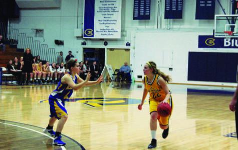 Kristin Sahr drives to the basket against St. Scholastica (Minn.)
