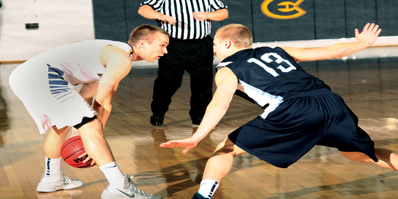 Sophomore guard Adam Hjelter handles the ball at the top of the key against UW-Stout Saturday afternoon.