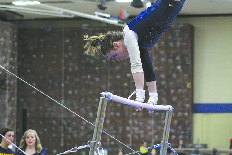 Sophomore Julia Stedman competes on the uneven bars Friday night.