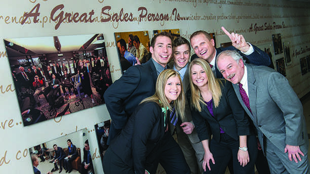 UW-Eau+Claire+College+of+Business+students%2C+who+qualified+to+compete+in+the+National+Collegiate+Sales+Competition%2C+posed+for+pictures+on+Friday%2C+February++7%2C+2014+in+Schnieder+Hall.+