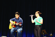 "Second-place winner Thomas Xiong and P.K. Yang perform ""In Case"" by Demi Lovato at Hmong's Got Talent."