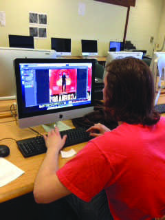 CAMERA AND ACTION: On Tuesday senior Jacoby Matott works on the movie poster for an independent films he's creating with friends. © 2014 Katie Bast