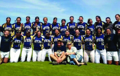 TRUE BLUGOLDS: Tim and Sue Rogge, center, pose with the UW-Eau Claire softball team earlier this season. The Rogges have been avid followers of the Blugold women's basketball, volleyball and softball teams since 2002. Submitted