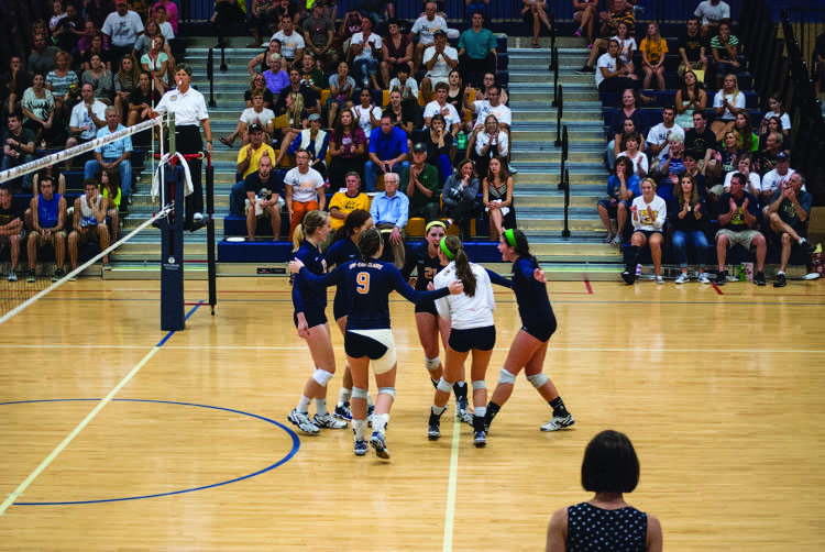 The+Blugolds+celebrate+a+point+in+a+match+Saturday+against+UW-La+Crosse.+The+Eagles+rallied+to+take+a+3-2+victory.