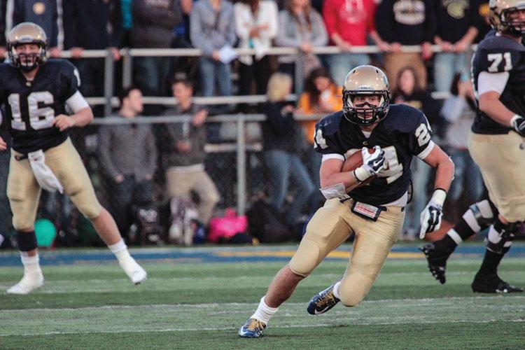 Freshman running back Jake Neis carries the ball against St. Johns (Minn.). The Blugold offense only rushed for 83 yards in a loss Saturday to Wheaton (Ill.).
