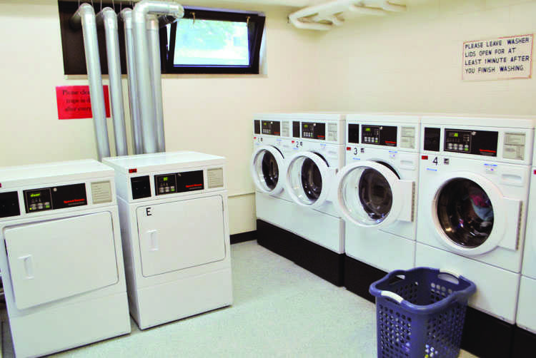 Every dorm washing machine, like these machines in Sutherland Hall, now costs $2.25. The cost increased from $2 because of changes in Eau Claires water system.