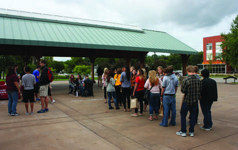 A big flock of UW-Eau Claire students tour the Phoenix Park area Friday night.