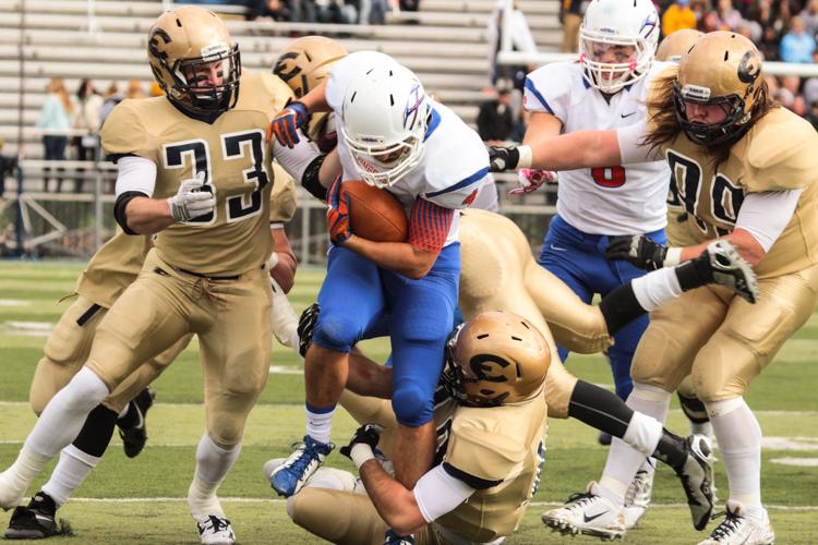 Brandon Luedke brings down UW-Plattevilles Dillon Villhauer as Cody Taubman (33) and Roger Steen (99) pursue the play.
