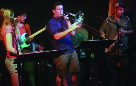 Tyler Henderson, Multimedia Editor of The Spectator, plays trombone with local funk band Love Taxi at The Mousetrap Tavern.