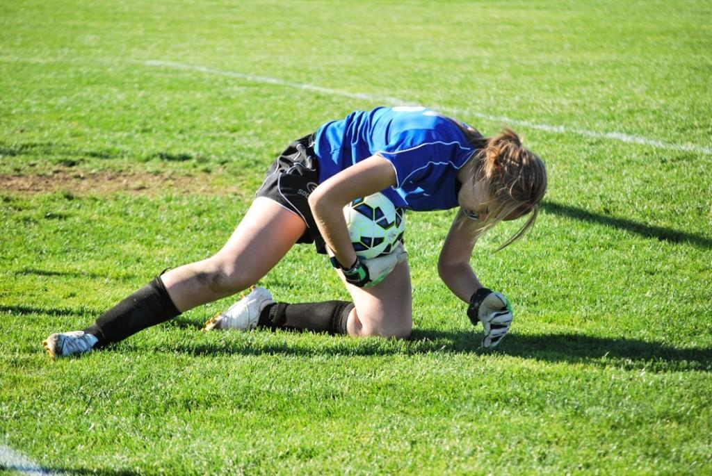Sophomore goalie Rachel Griffiths records one of her five saves Saturday against UW-Oshkosh.