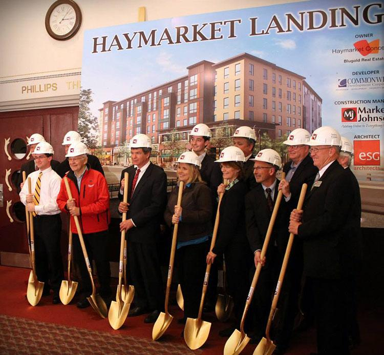 Several people involved with the Confluence Project pose for a photo during the Groundbreaking Shovel Ceremony in the State Theatre. The Haymarket Groundbreaking Ceremony marked the start of construction on the mixed use Haymarket Landing building downtown. - Submitted Photo