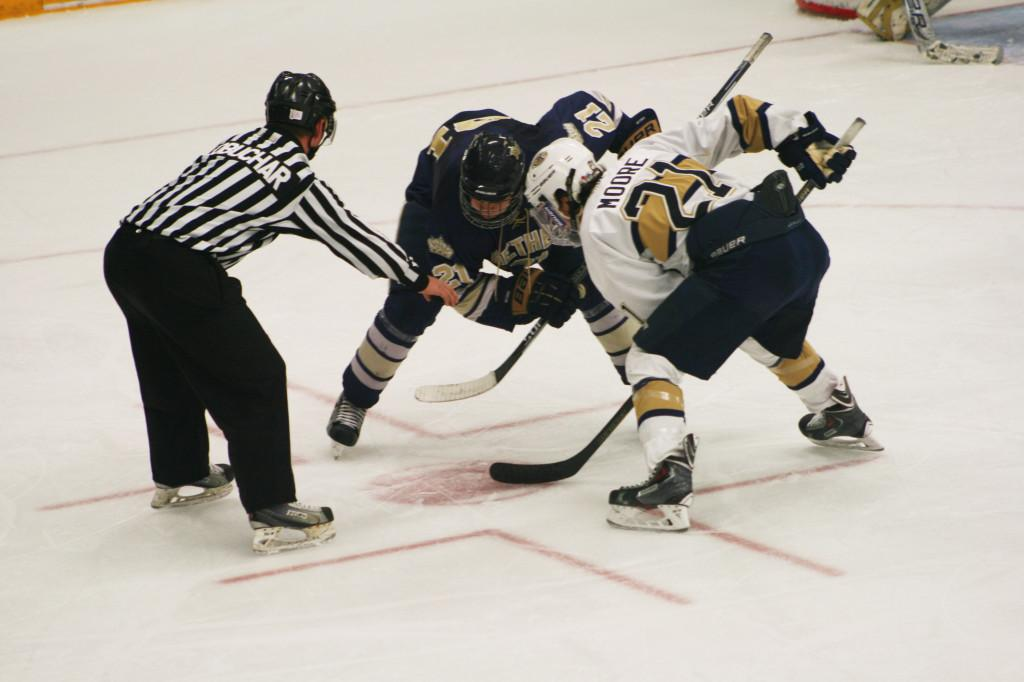 Patrick Moore faces off in a win against Bethel (Minn.) Saturday night.