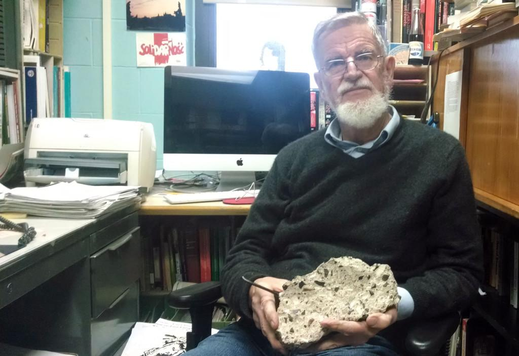 Paulis Lazda, professor of history at UW-Eau Claire, has a piece of the Berlin Wall in his office that he hammered out himself. He spoke at the university's 25th anniversary discussion of the fall of the wall.