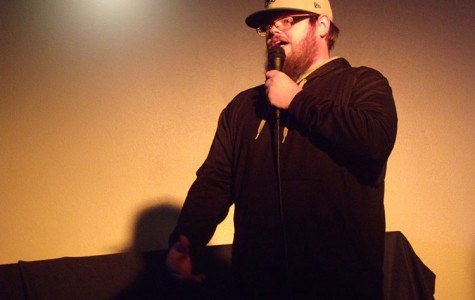 JOKE'S ON YOU: Justin Schenck closes an evening of comedy at Pizza Plus on Tuesday. He is one of several comedians who regularly performs at Tuesday open-mic nights. - Photo by Sam Martinez