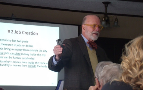 Dr. Brady Foust shares his presentation on the economic benefits of the Confluence Project at Fanny Hill Resteraunt on Wednesday. His presentation was part of the