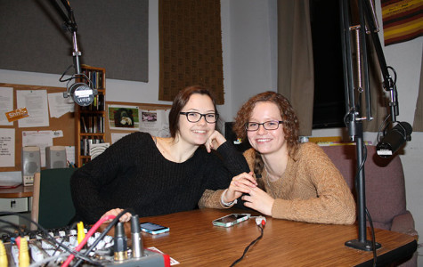 """Sammy Gibbons and Emma Barnhardt joke with each other Tuesday night in the WHYS 96.3 FM Eau Claire Community Radio booth in downtown Eau Claire. The Memorial High School seniors host a weekly program, """"Generation WHYS."""" Barnhardt and Gibbons have both taken classes at UW-Eau Claire through the Youth Options program, along with being full-time high school students and partaking in extracurricular activities."""