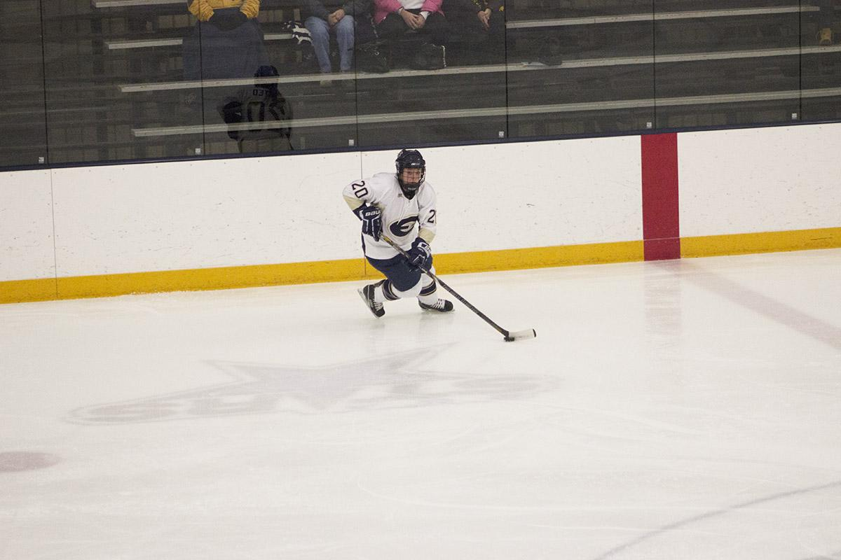 Senior Andi Husted skates up ice into the Yellow Jackets zone looking for a shot Friday night.