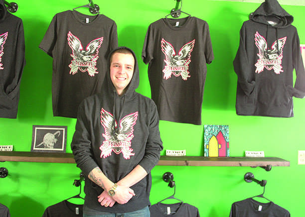 Chris Johnson, owner of Passion Board Shop stands in his store downtown, located at 305 S. Barstow St. Johnson and others raised money Saturday for a proposed second Eau Claire stakepark.