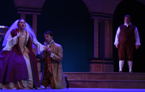 Seth Hale (middle) as Count Almaviva is trying to seduce Kelly Noltner (left) as Susanna while Jacob Burgess (right) as Figaro watches.
