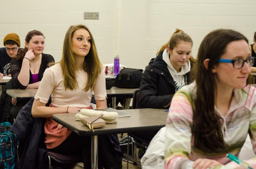 Sophomore Mass communication major Kendall Ruchti (middle) and behind her Helen White look toward the front of the classroom, located in Hibbard Hall. While these two seem to be paying attention, academic mishaps aren't uncommon within the walls of Hibbard.