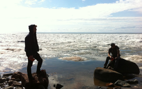 Simon Dowling, left, and Mattheus De Waard enjoy Lake Superior on a geography field trip last spring.