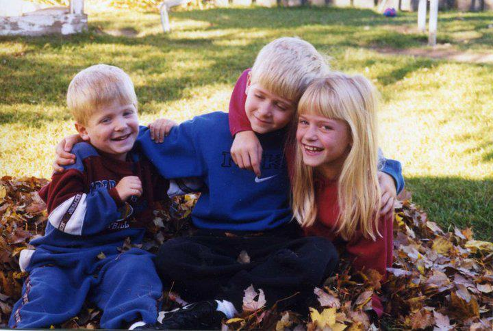 Copy Editor Trent Tetzlaff, brother Trevor and sister Kayla from 1997 in their backyard in Appleton.