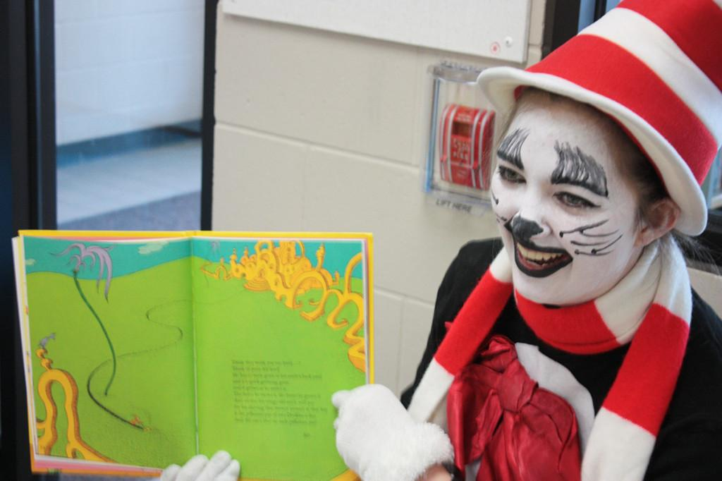 Anneliese Ramin, senior, dresses up as the Cat and the Hat and reads to kids.