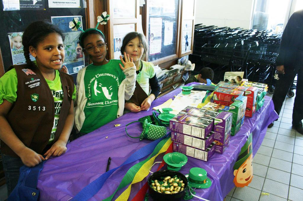 Girl scouts selling cookies at Festival Foods