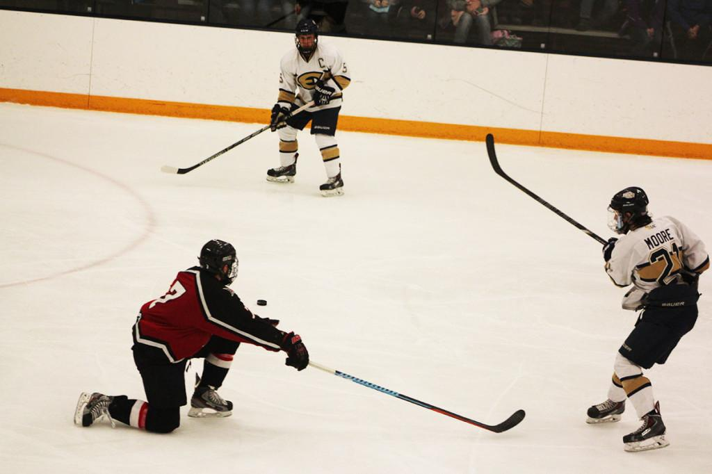 Patrick Moore passes the puck to Jack Callahan against the Falcons.