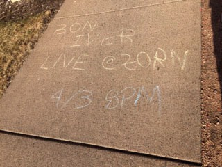 A message stating Bon Iver was to perform Friday was written around campus in chalk. It is in fact just an April Fools' Day joke.