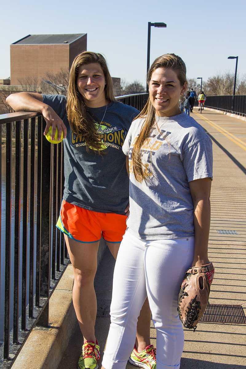 Senior softball captains Amanda Fischer and Nikki Brooks take to the footbridge before practice.