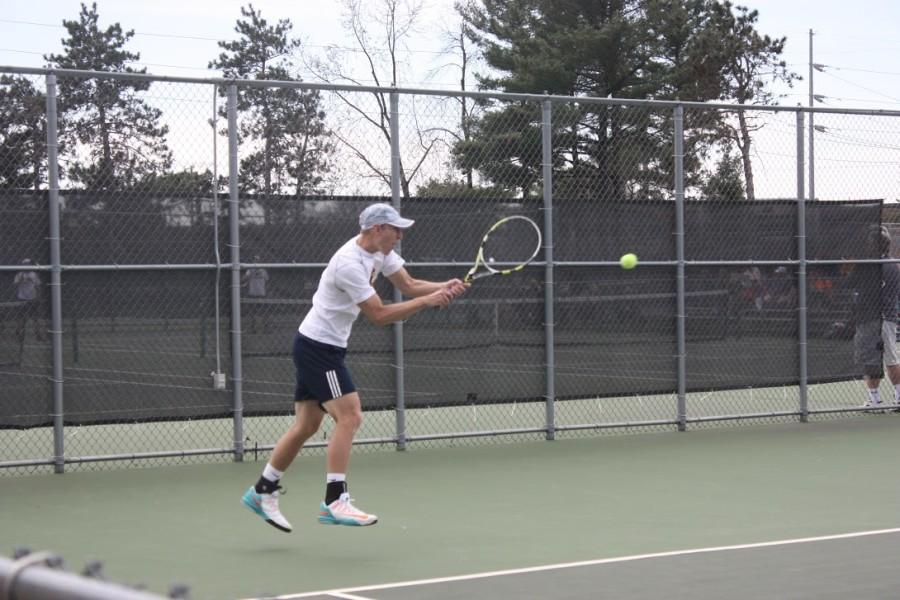 Sophomore Conrad Felten returns a Whitewater serve Saturday afternoon outside of McPhee Physical Education Center.