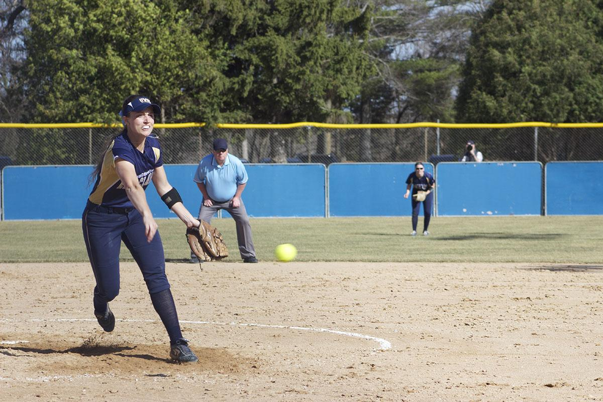 Senior pitcher Laura Raflik shoots off the mound at a Marian batter to land the third out in the top of the fifth inning.