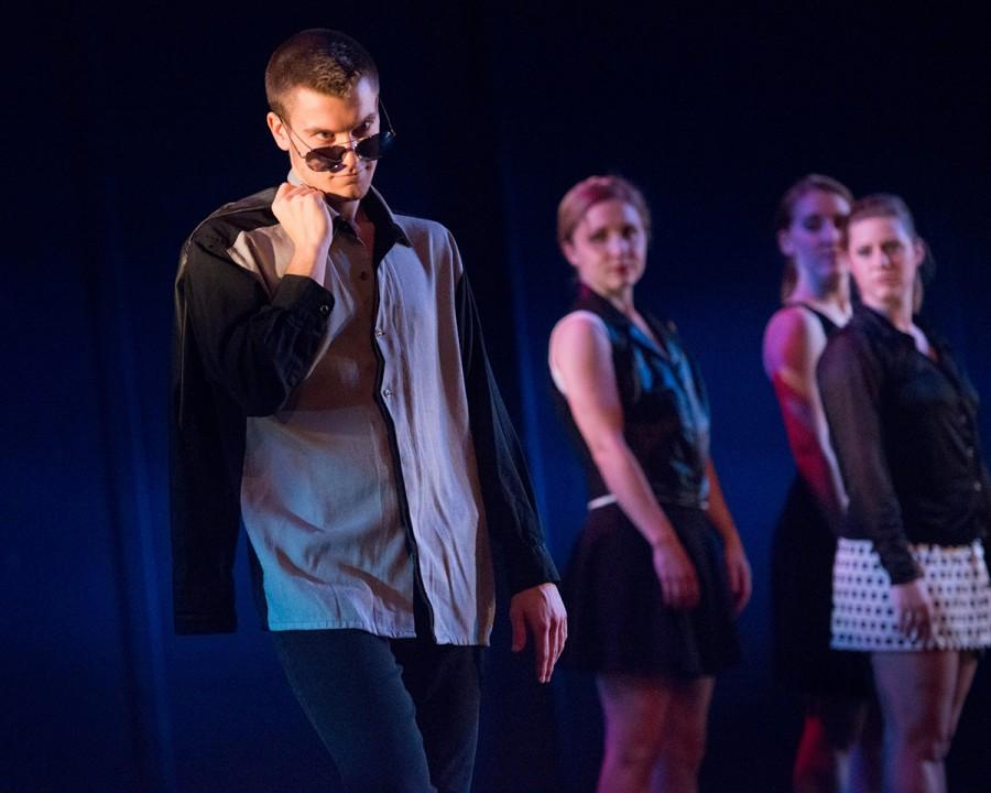 """Senior Mic Nelson struts his stuff for the crowd in the second piece of the show, titled """"My Eyes are Sizzling."""""""