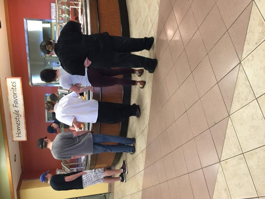 Students wait in the buffet line for breakfast at the Hilltop dining facility.