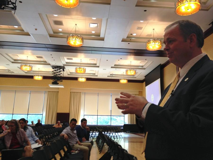 Chancellor Schmidt talks budget cuts with a group of faculty and staff on Aug. 27 in the Ojibwe Ballroom of the Davies Center.