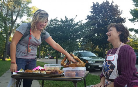 Homeowner Jennifer Eddy and Junior Sarah Fulton share a laugh over muffins.