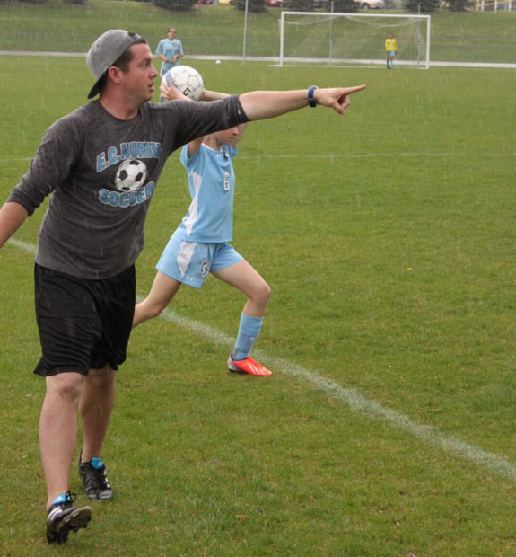 Henderson barks out orders to the Eau Claire North JV girls soccer team he coached last year.